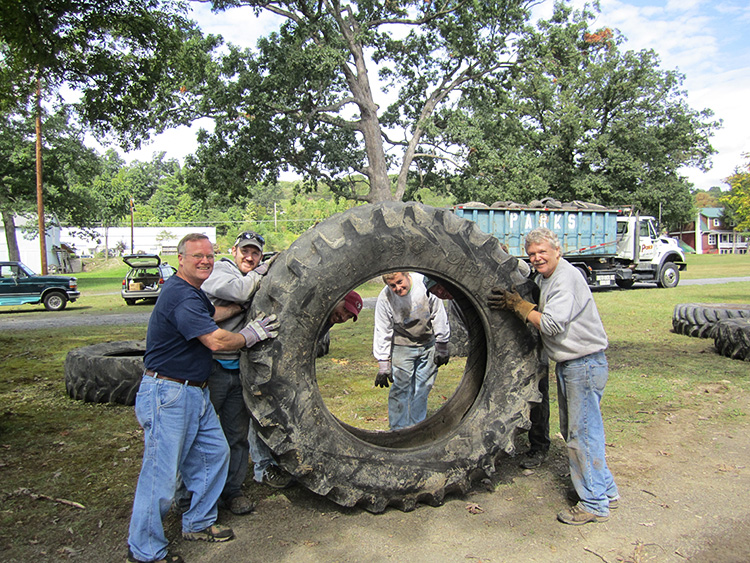 Tire War photo, group holding a large tire