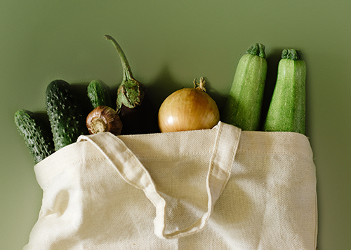 Vegetables in reusable cotton white bag