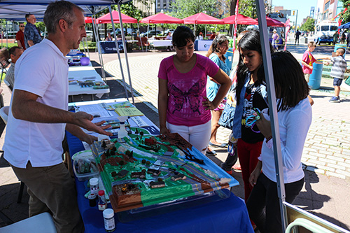 People learn about storm water at their local farmer's market
